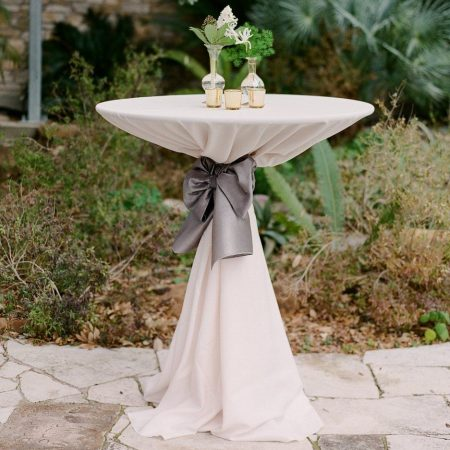 cocktail table with linen and sash